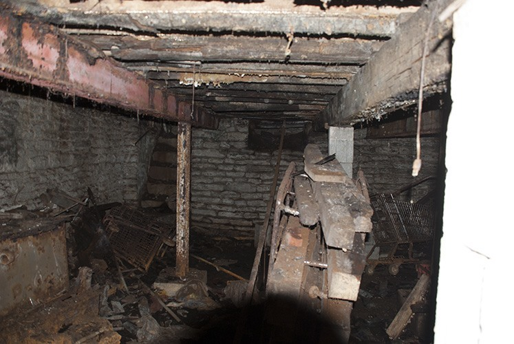 Basement detail showing decayed floor joists